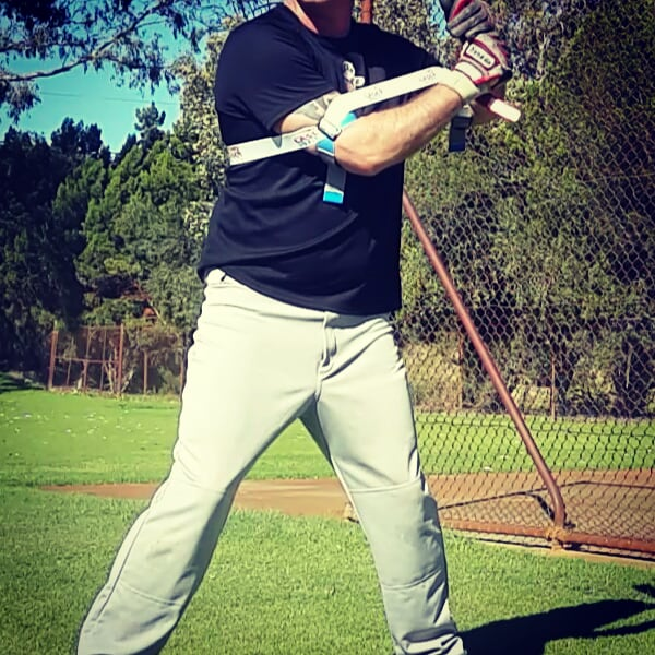 Gripping the bat with a loose grip, relaxing your shoulders, and arms.