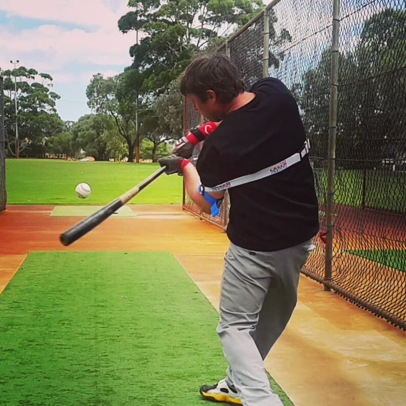 Hands inside the ball baseball swing trainer. Resistance improves strength, frontside and backside mechanics.