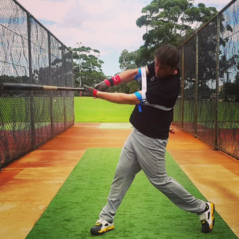 To cut down on strikeouts, and improve swing consistency stay balanced with your lower body, and keeping your head in the middle of your legs, and still on your follow through.